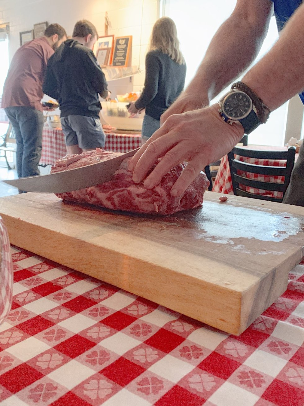 Top 5 Best Destination Restaurants in Eastern NC you Need to Try by popular North Carolina blog, I'm Fixin' To: image of meat being cut at the Beefmastor Inn.