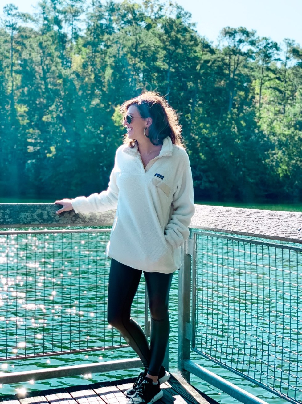 Eastern North Carolina Travel Guide: Top 10 Things to Do in Goldsboro NC by popular North Carolina blog, I'm Fixin' To: image of a woman standing outside in Neuse.