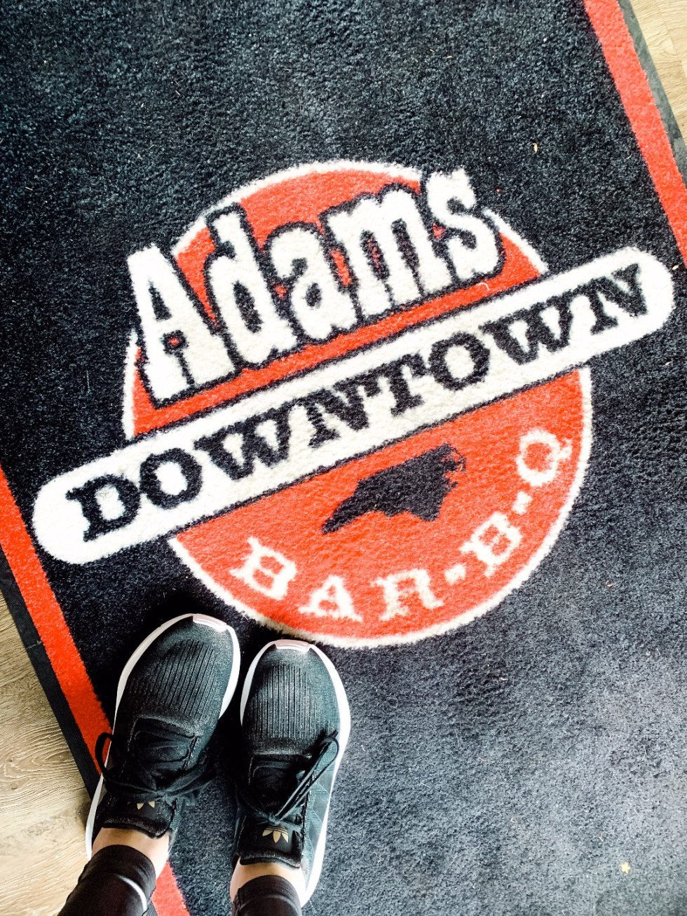Eastern North Carolina Travel Guide: Top 10 Things to Do in Goldsboro NC by popular North Carolina blog, I'm Fixin' To: image of Adams Downtown Bar-B-Q floor mat.