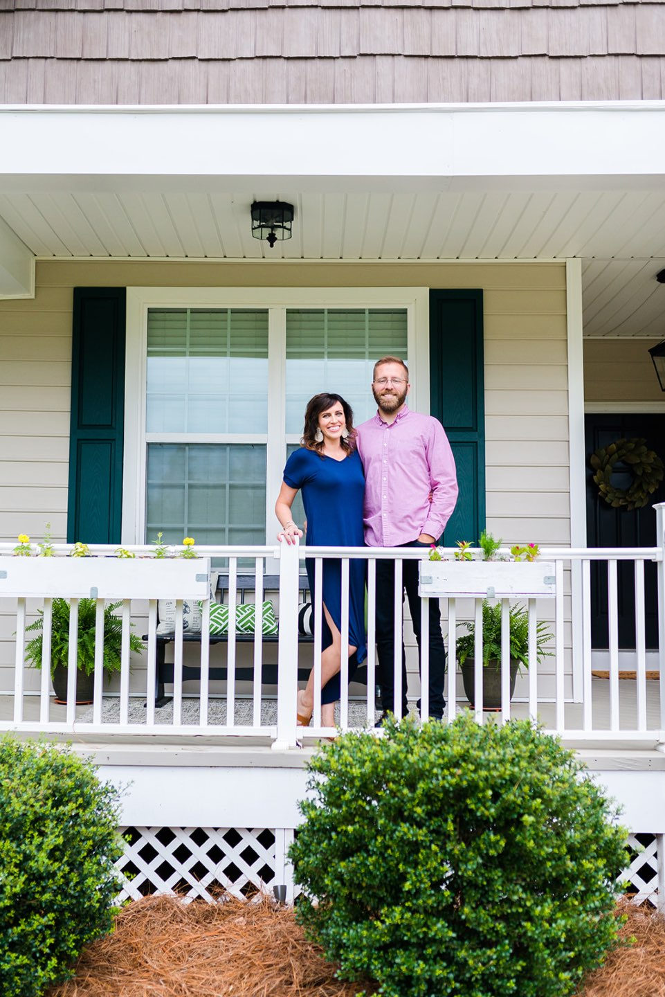 Second Year Updates to Our Ranch - I'm Fixin' To - @mbg0112 \ Our Updated Ranch House by popular North Carolina life and style blog, I'm Fixin' To: image of a couple standing together on the porch of their updated ranch house.