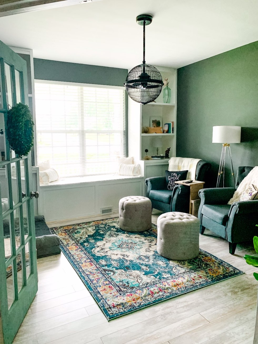 Second Year Updates to Our Ranch - I'm Fixin' To - @mbg0112 | Our Updated Ranch House by popular North Carolina life and style blog, I'm Fixin' To: image of a sitting room in an updated ranch house decorated with Chairs, Ottomans, Lamp, Rug, Fandelier, Pillow Covers