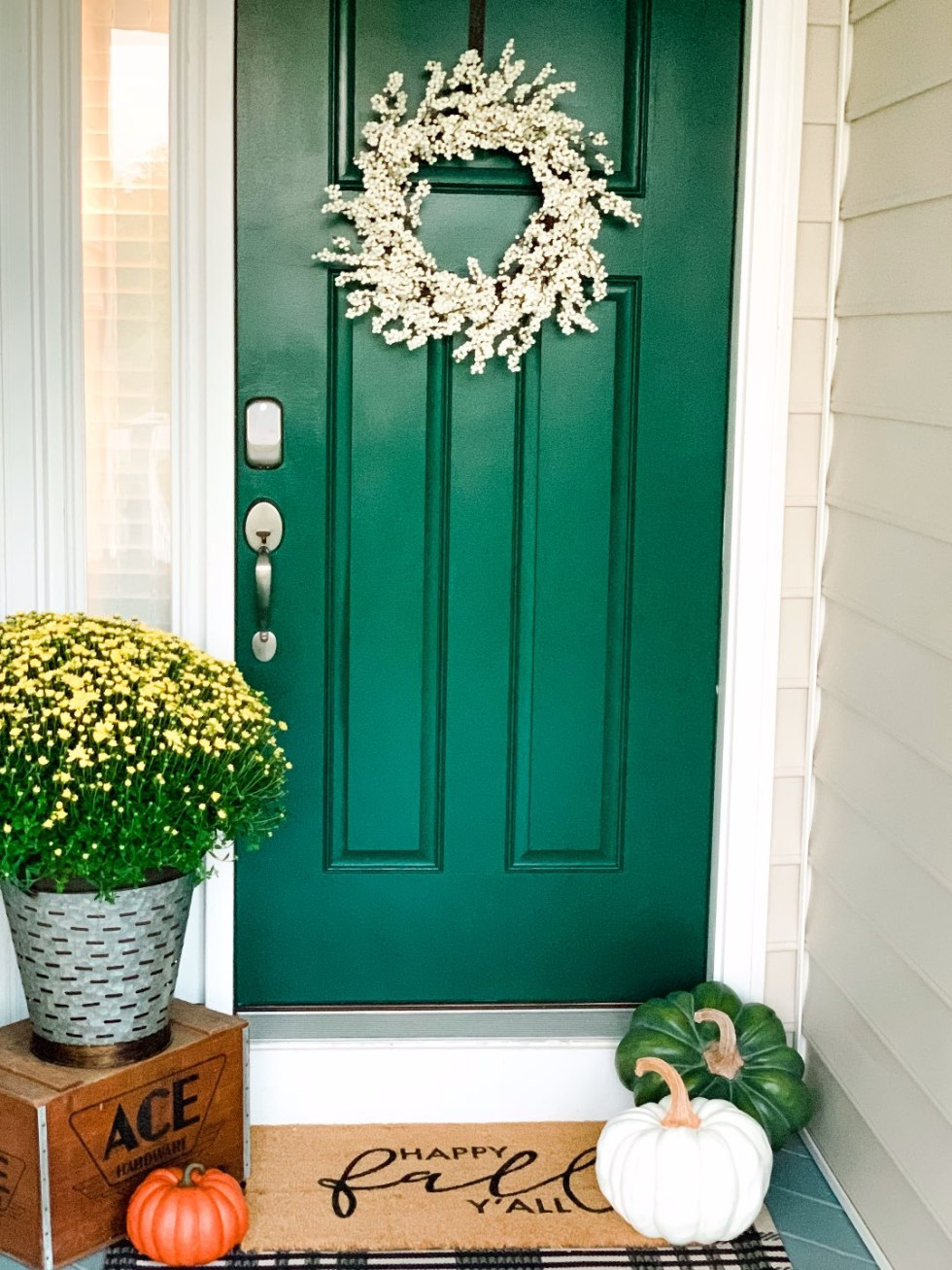 Our Fall Home Decor & Foyer Reveal - I'm Fixin' To - @mbg0112 | Cozy Fall Decor Ideas for your Home & Foyer by popular North Carolina life and style blog, I'm Fixin' To: image of a front porch decorated with various Fall decor.