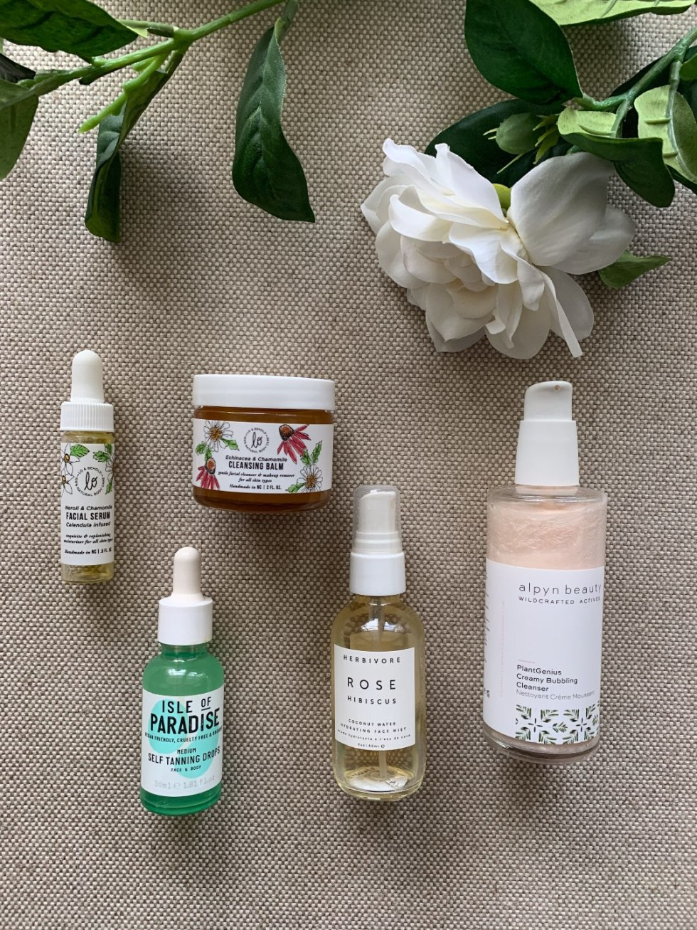 Fall Skincare Routine: Top 10 Products to Use this Season - I'm Fixin' To - @mbg0112 | Fall Skincare Routine: Top 10 Products to Use this Season by popular North Carolina beauty blog, I'm Fixin' To: image of Lo & Behold Cleansing Balm, Alpyn Beauty Wildcrafted Creamy Bubbling Cleanser, Herbivore Rose Water Spray, Lo & Behold Neroli & Chamomile Facial Serum, and Isle of Paradise Self Tanning Drops.