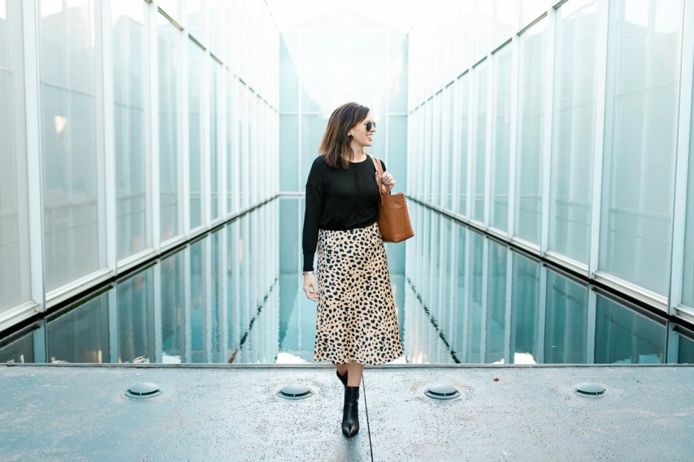 4 Outfit Ideas for Thanksgiving Supper - I'm Fixin' To - @mbg0112 | 4 Thanksgiving Outfit Ideas by popular North Carolina fashion blog, I'm Fixin' To: image of a woman outside wearing a H&M Fine-knit Top, Amazon Pajamasea High Waist Leopard Midi Skirt Hidden Elasticized Waistband, and Nordstrom Marc Fisher Unique Bootie.