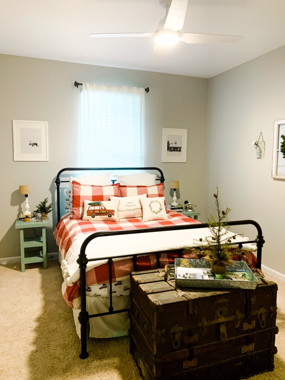 Holiday Home Decor Tour - I'm Fixin' To - @mbg0112 | Holiday Home Decor Tour by popular North Carolina life and style blog, I'm Fixin' To: image of a guest bedroom with a Pottery Barn Bryce Buffalo Check Cotton Duvet Cover & Shams, Target Inspire Q Tilden Standard Metal Bed, Etsy Christmas Wall Art, Pottery Barn Cozy Pom Pom Throw, and Amazon Golden State Art.