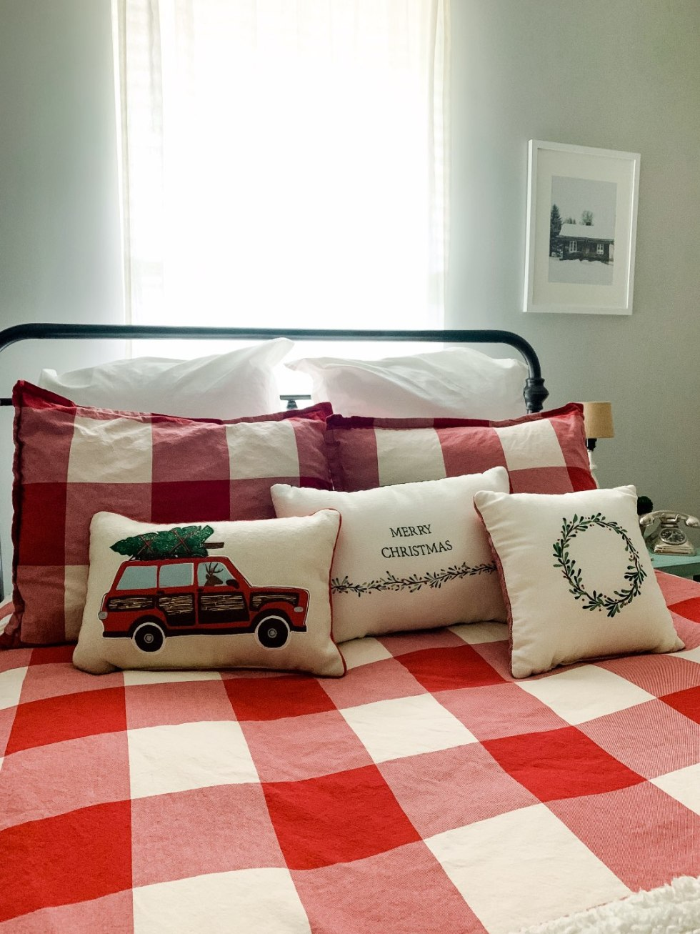 Holiday Home Decor Tour - I'm Fixin' To - @mbg0112 | Holiday Home Decor Tour by popular North Carolina life and style blog, I'm Fixin' To: image of a guest bedroom bed with a Pottery Barn Bryce Buffalo Check Cotton Duvet Cover & Shams, Target Inspire Q Tilden Standard Metal Bed, Etsy Christmas Wall Art, Pottery Barn Cozy Pom Pom Throw, and Amazon Golden State Art.