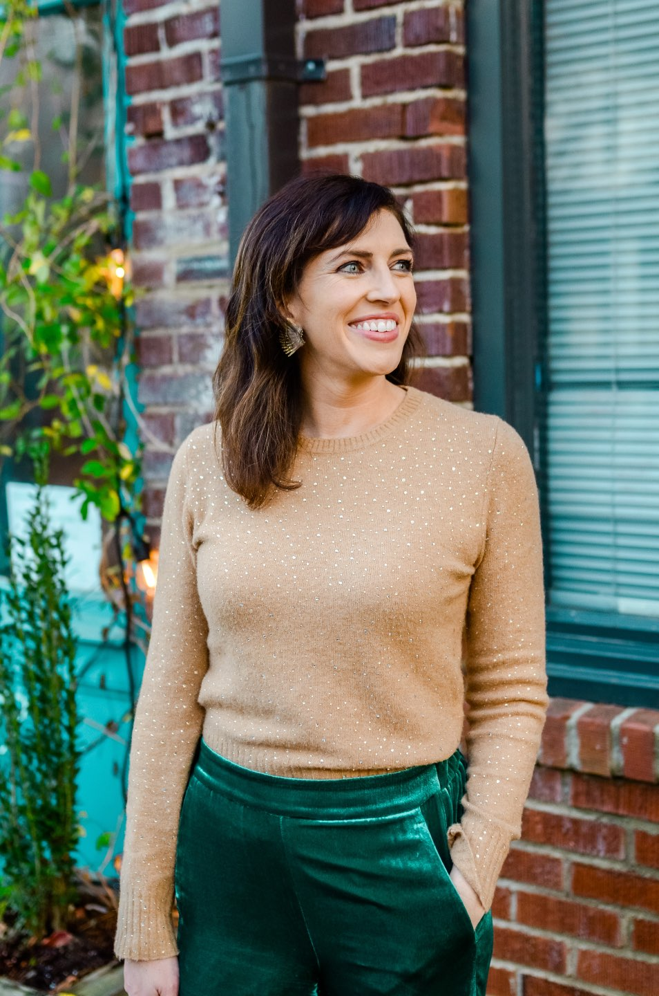 Holiday Style and Outfit Inspiration - I'm Fixin' To - @mbg0112 | Holiday Style and Outfit Inspiration by popular North Carolina fashion blog, I'm Fixin' To: image of a woman outside wearing a J. Crew Gemstone sweater in supersoft yarn, J. Crew Pull-on Peyton pant in velvet, metallic mules, Cuyana Small Structured Leather Tote, Nordstrom David Yurman Cable Classic Buckle Bracelet with 18K Gold, Nordstrom David Yurman Cable Classics Bracelet with 14K Gold, Nordstrom Mignonne Gavigan Earrings, and Sephora Bite Beauty lipstick.