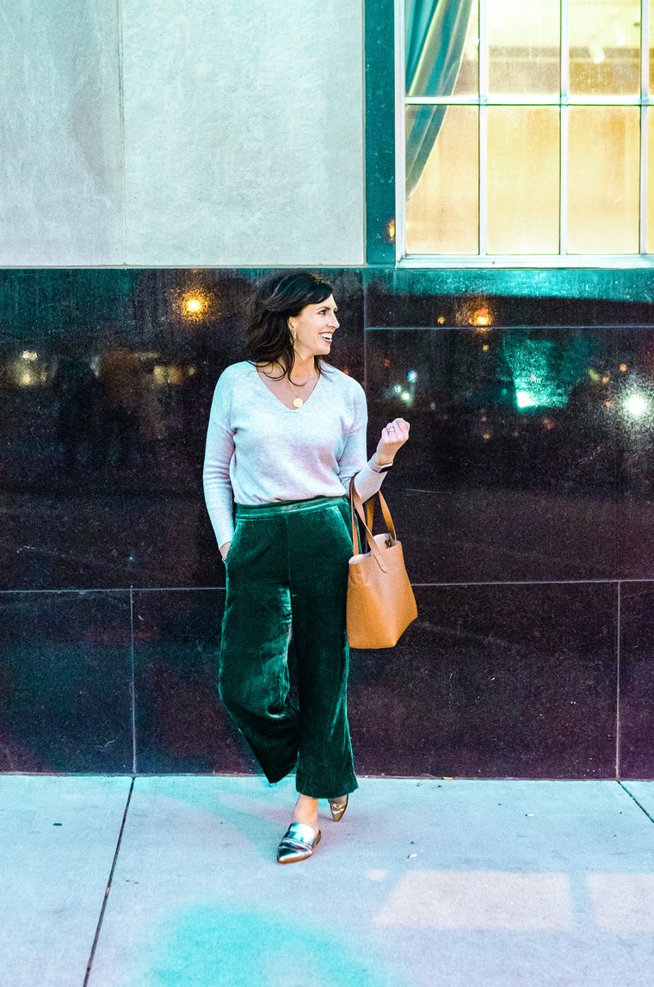 Holiday Style and Outfit Inspiration - I'm Fixin' To - @mbg0112 | Holiday Style and Outfit Inspiration by popular North Carolina fashion blog, I'm Fixin' To: image of a woman outside wearing a Loft FLECKED LUXE KNIT V-NECK SWEATER, J. Crew Pull-on Peyton pant in velvet, metallic mules, Cuyana Small Structured Leather Tote, Nordstrom David Yurman Cable Classic Buckle Bracelet with 18K Gold, Nordstrom David Yurman Cable Classics Bracelet with 14K Gold, Nordstrom Mignonne Gavigan Earrings, and Sephora Bite Beauty lipstick.