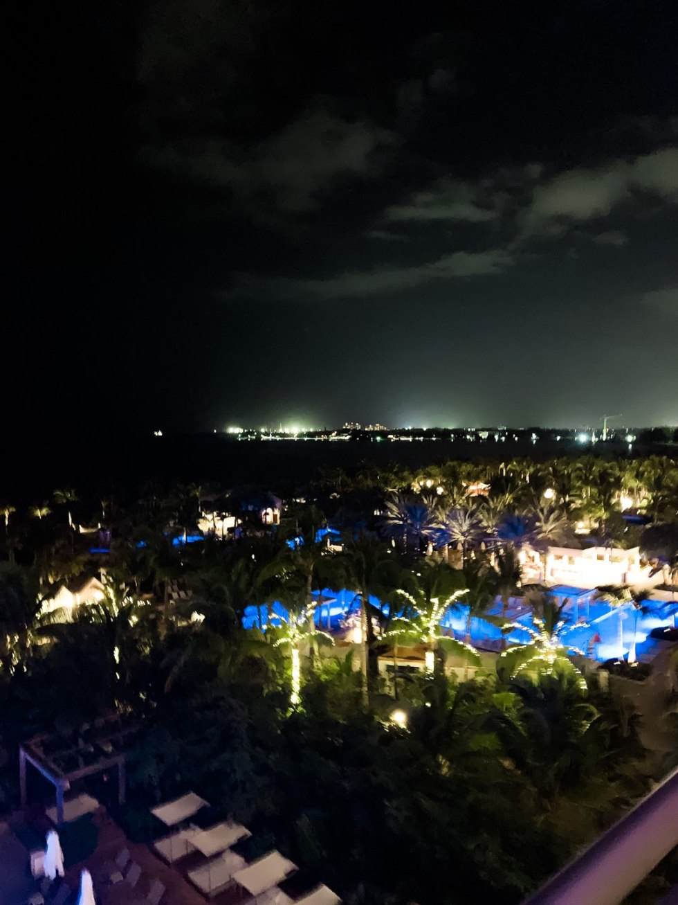 Warming Up in the Bahamas: the Best Things to Do at Baha Mar - I'm Fixin' To - @mbg0112 | Warming Up in the Bahamas: the Best Things to Do in Baha Mar by popular North Carolina travel blog, I'm Fixin' To: image of palm trees with white lights on them.