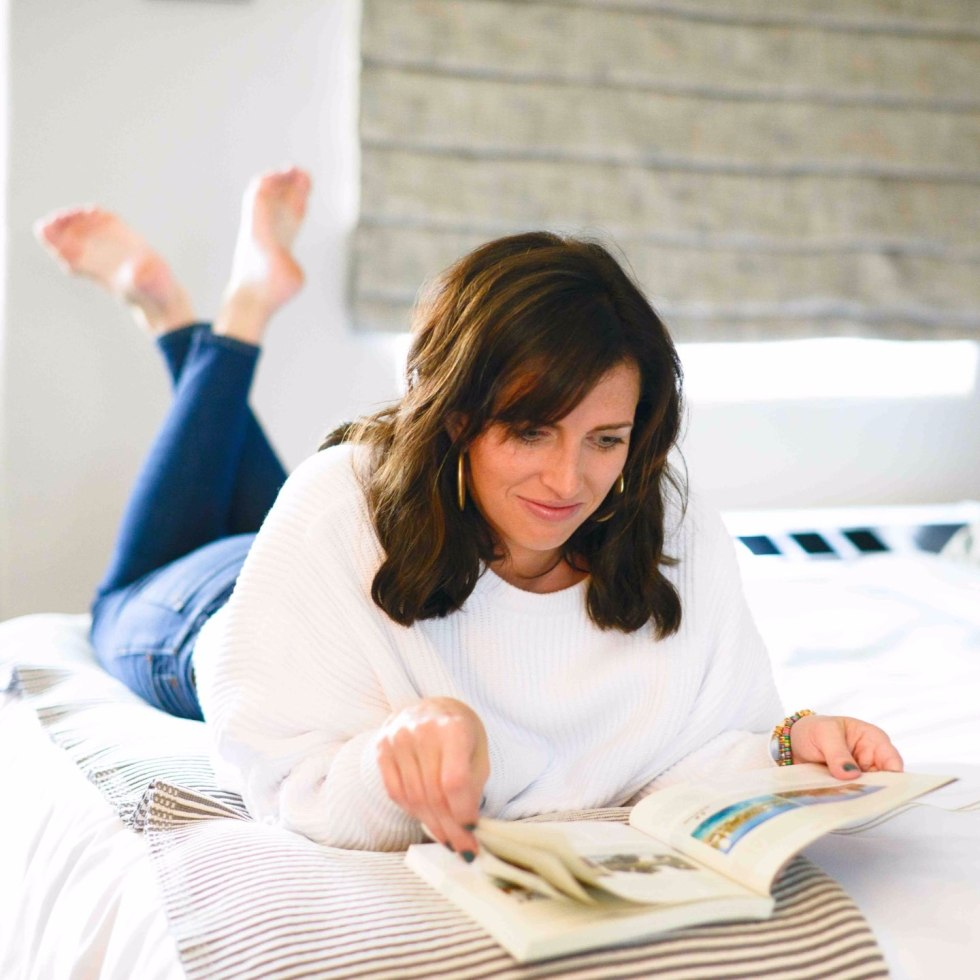 How to Set Healthy Boundaries with Friends: 8 Essential Tips - I'm Fixin' To - @mbg0112 | How to Set Healthy Boundaries with Friends: 8 Essential Tips by popular NC life and style blog, I'm Fixin' To: image of a woman laying on her bed and looking at a book.
