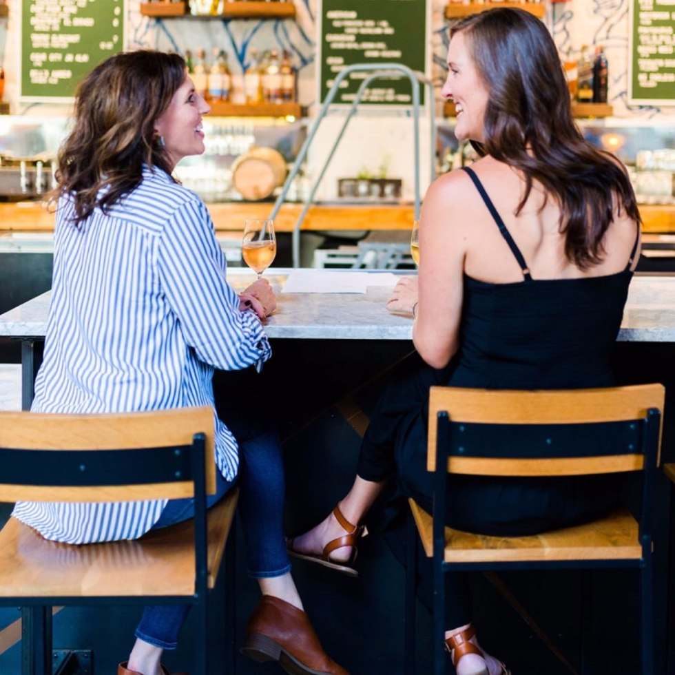 How to Set Healthy Boundaries with Friends: 8 Essential Tips - I'm Fixin' To - @mbg0112 | How to Set Healthy Boundaries with Friends: 8 Essential Tips by popular NC life and style blog, I'm Fixin' To: image of a woman sitting at a bar with a friend.