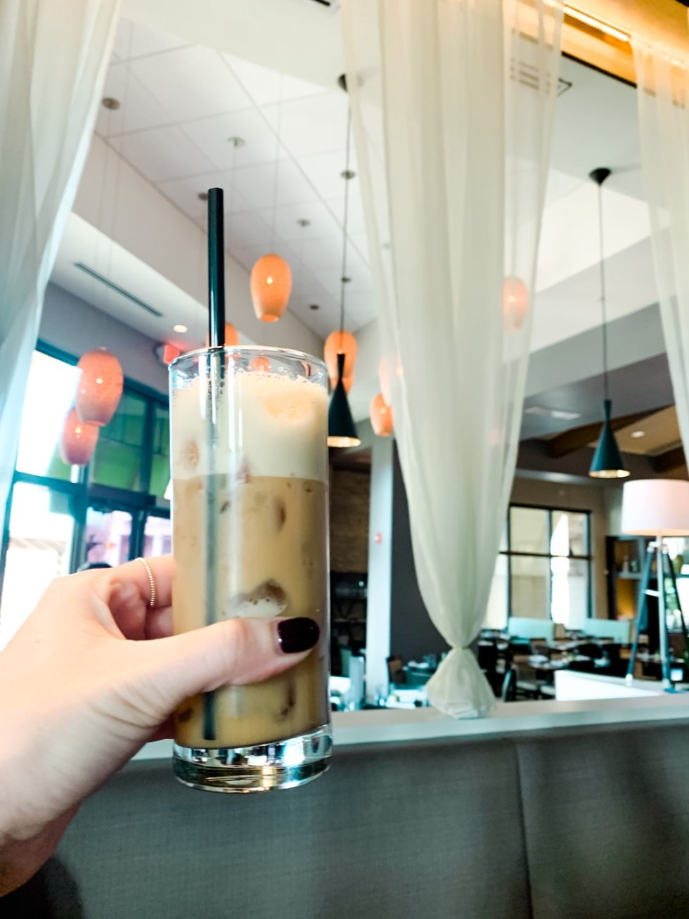 Brunch in Raleigh by popular Raleigh blog, I'm Fixin To: image of a woman holding an iced coffee at so*ca.