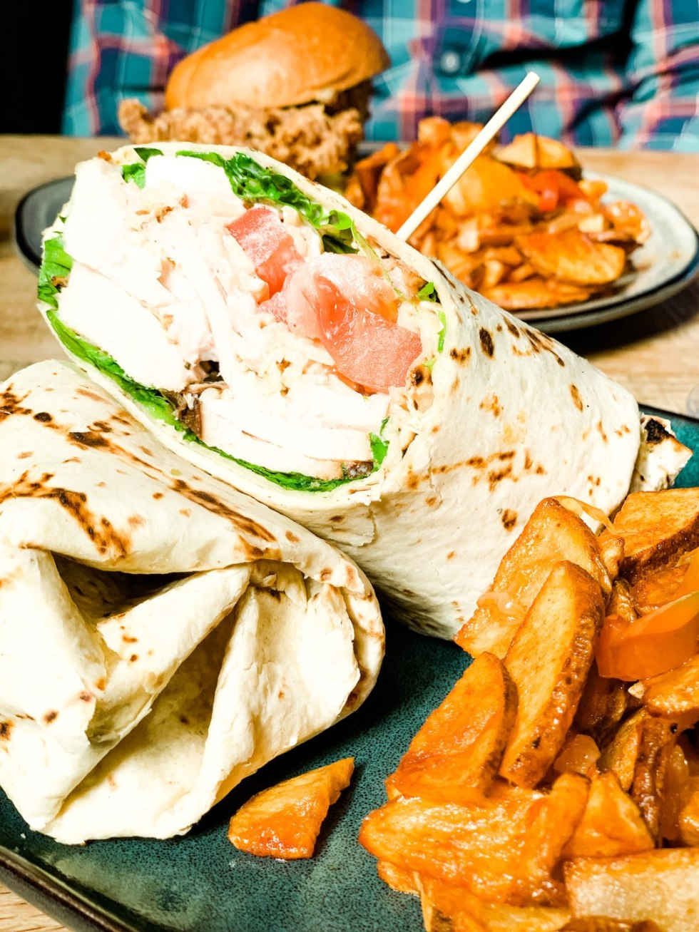 Where to Get Brunch in Raleigh: the 7 Best Spots - I'm Fixin' To - @mbg0112 | Brunch in Raleigh by popular Raleigh blog, I'm Fixin To: image of Whiskey Kitchen chicken wrap.