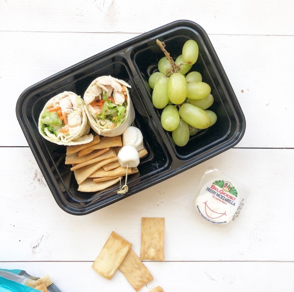 The Empowered Women Series: On the Go Lunch Ideas for Teachers with Kayte Fry by popular NC life and style blog, I'm Fixin To: image of Walmart Mainstays Meal Prep Food Storage Container with pita chips, chicken wraps, green grapes, and fresh mozzarella.