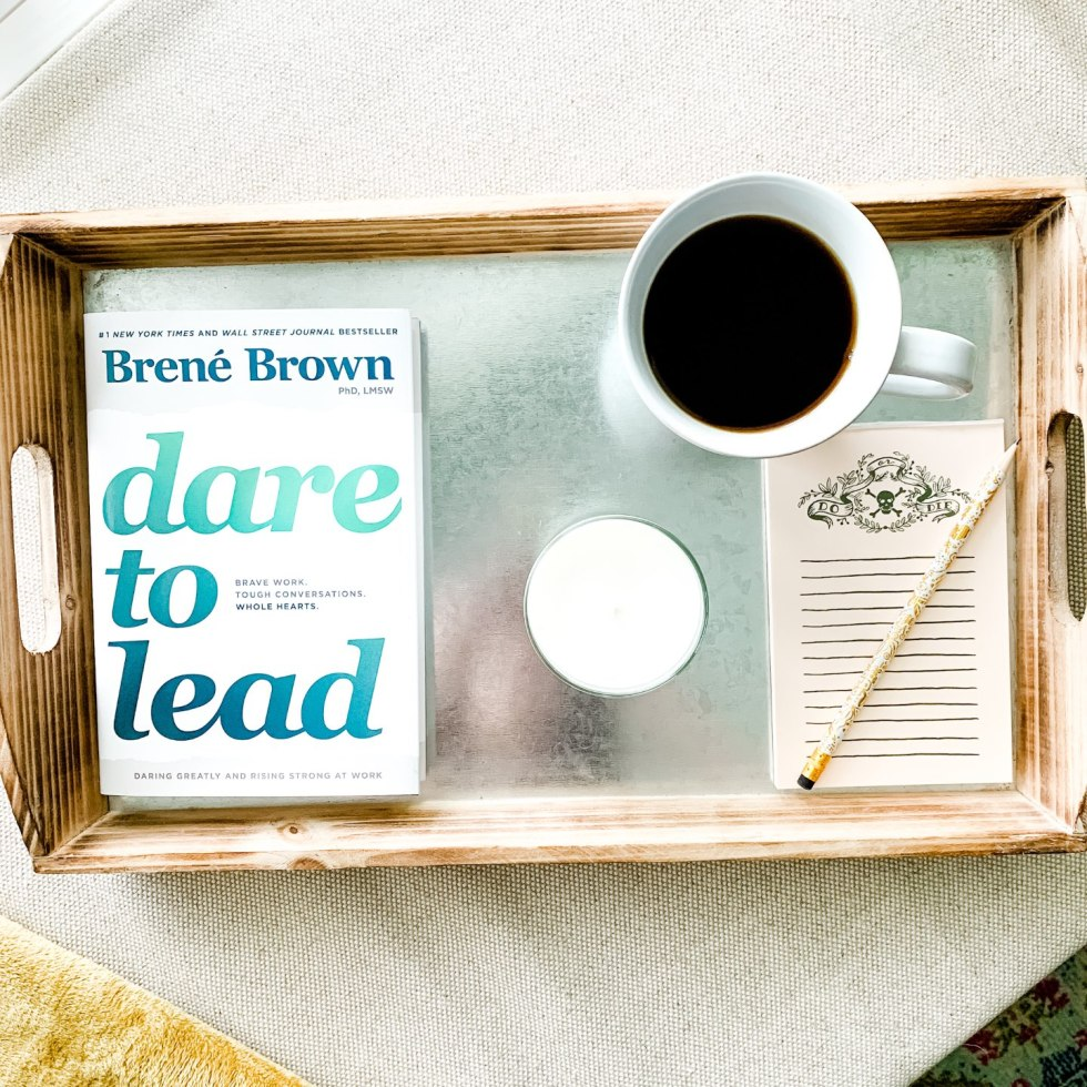 Home Office Decor and Reveal - I'm Fixin' To - @mbg0112 | Home Office Decor by popular NC lifestyle blog, I'm Fixin' To: image of a home office with a wood and metal serving tray containing a ceramic mug of coffee, cadle, note pad, pencil, and Brene Brown 'Dare to Lead' book.