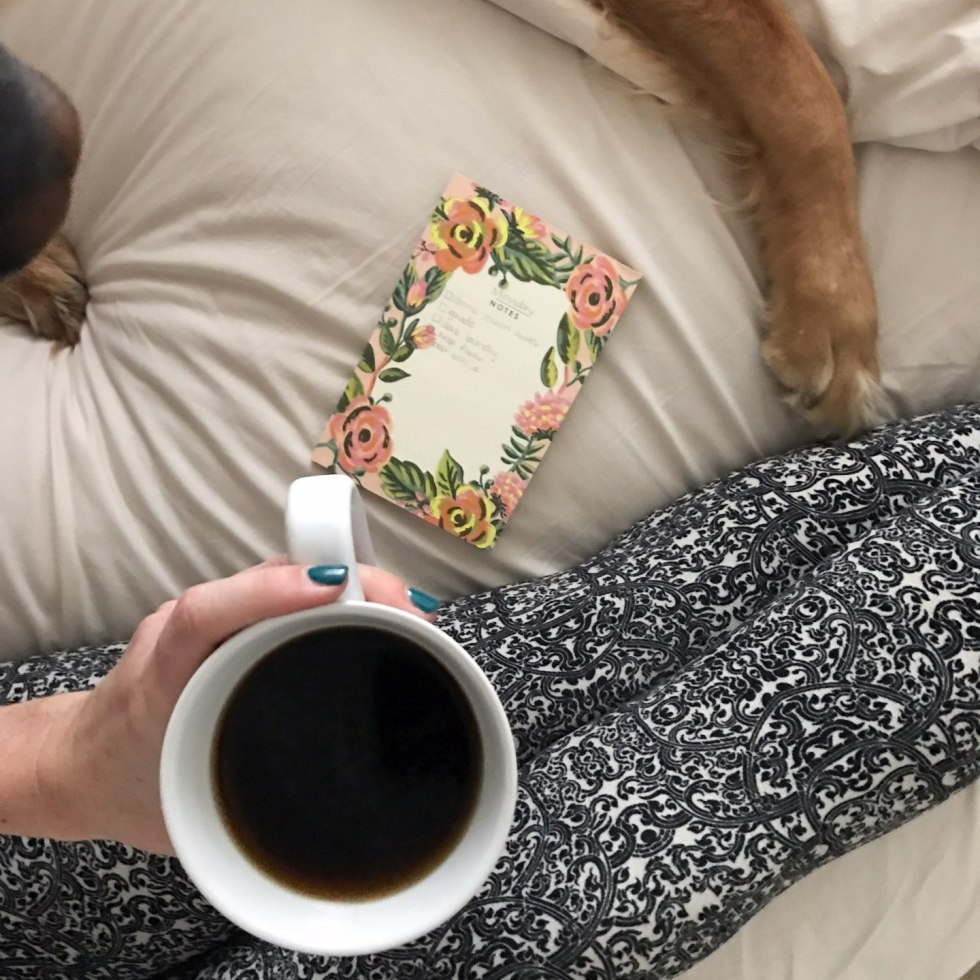 How I'm Learning to Do Nothing - I'm Fixin' To - @mbg0112 |  Learning to do Nothing by popular N.C. lifestyle blog, I'm Fixin' To: image of a woman sitting on her bed and holding a mug of coffee.