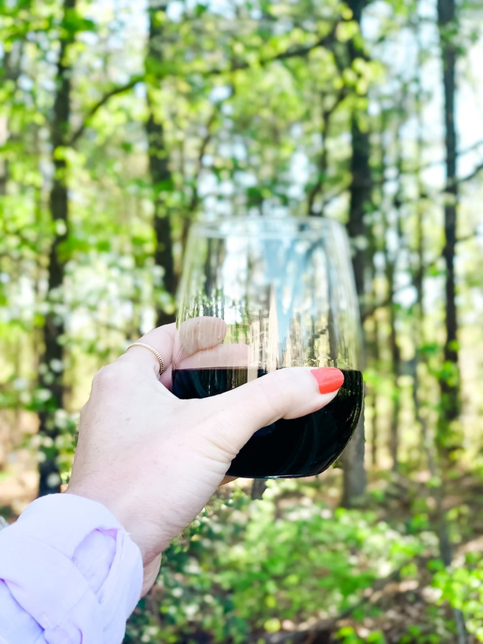 How to Master the Perfect Manicure at Home - I'm Fixin' To - @mbg0112 |  Home Manicure Essentials by popular NC beauty blog, I'm Fixin' To: image of a woman with a red polish manicure and holding a stemless wine glass.