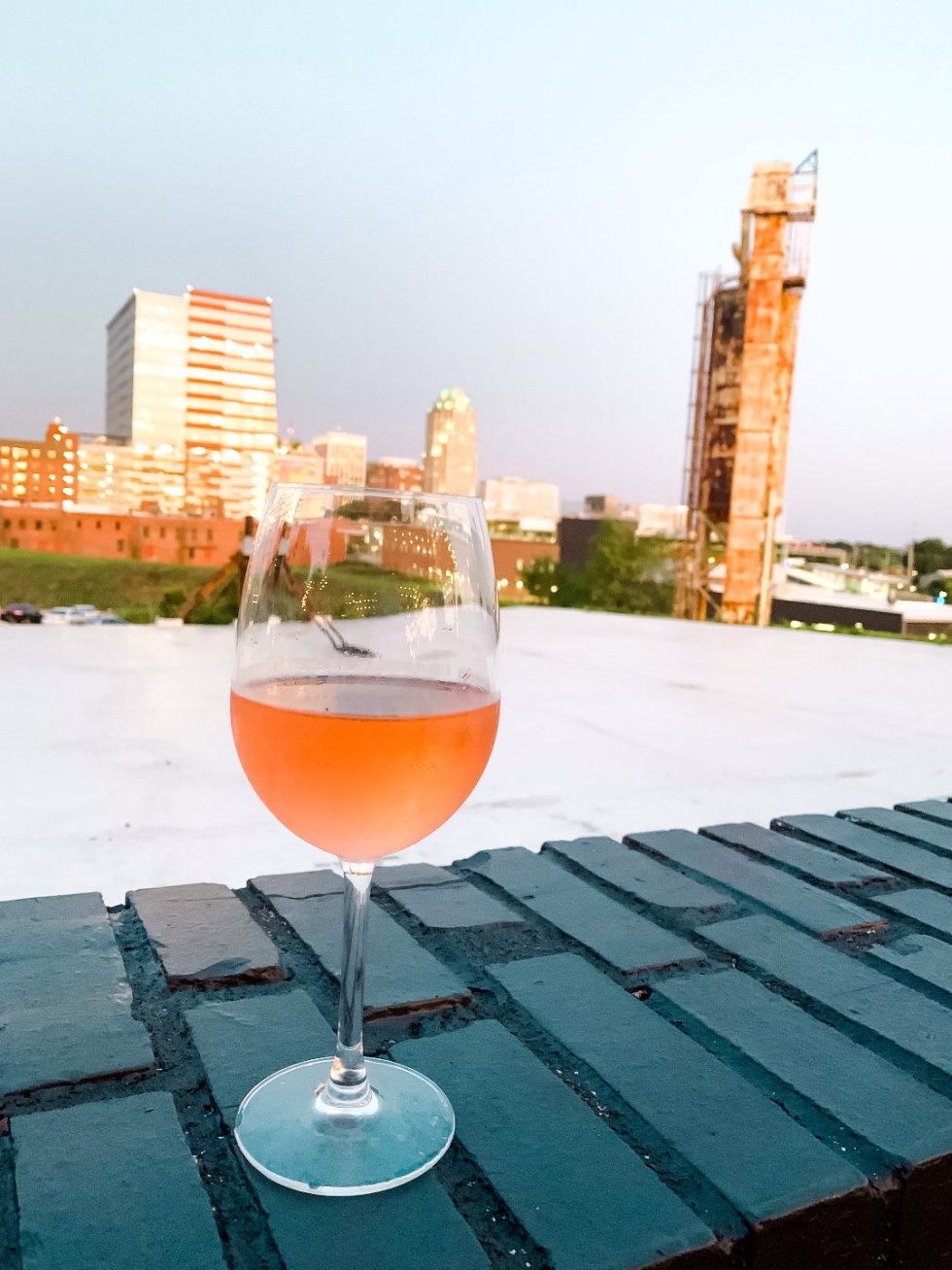 The 20 North Carolina Restaurants I Can't Wait to Visit after Quarantine - I'm Fixin' To - @mbg0112 | Best North Carolina Restaurants by popular N.C. blog, I'm Fixin' To: image of a alcoholic beverage at Wye Hill restaurant.