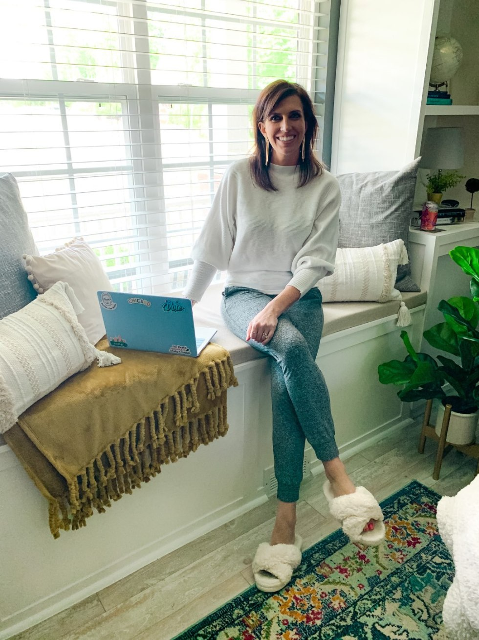 5 Stylish Teleworking Outfits for Women - I'm Fixin' To - @mbg0112 | Teleworking Outfits for Women by popular North Carolina fashion blog, I'm Fixin' To: image of a woman sitting on a window bench and wearing a Amazon GABERLY Boat Neck Batwing Sleeves Dolman Knitted Sweater and Nordstrom Serene Cozy Mélange Jogger Pants ZELLA.
