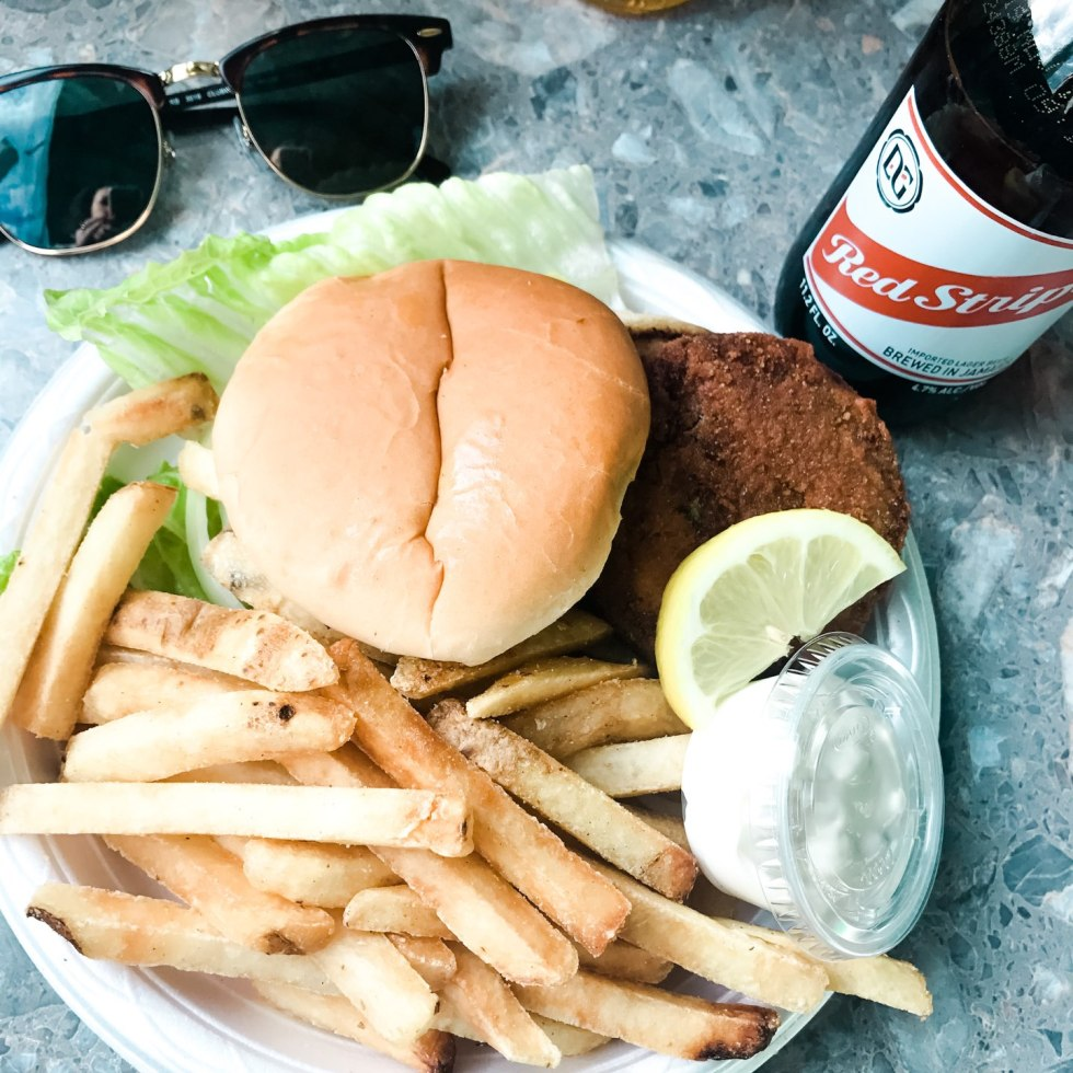 10 North Carolina Destinations Perfect for a Socially Distant Getaway - I'm Fixin' To - @mbg0112 | North Carolina Destinations by popular North Carolina blog, I'm Fixin' To: image of a chicken sandwich and french fries.