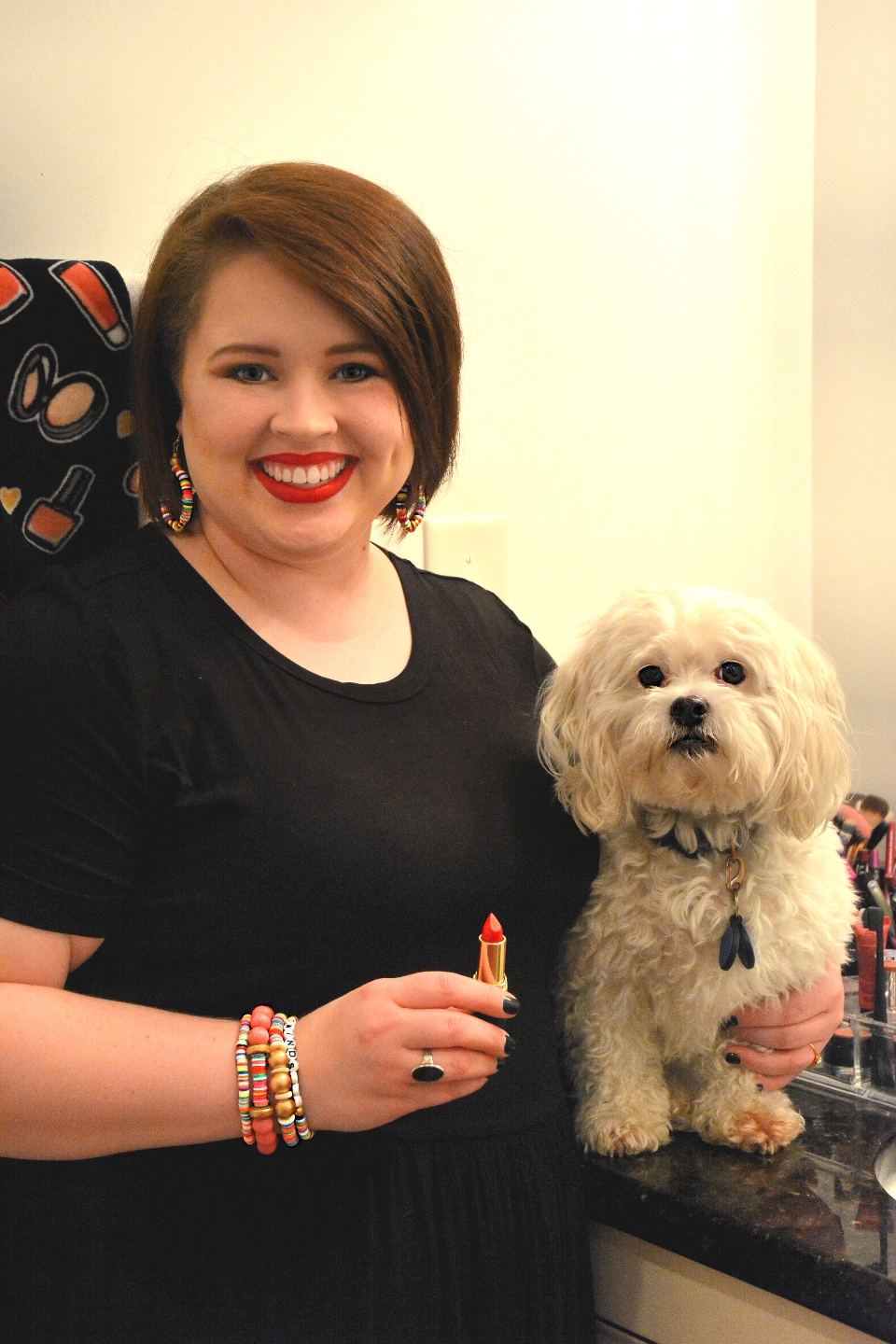 The Empowered Women Series: How to Rock a Red Lip with Hannah Dawson - I'm Fixin' To - @mbg0112 | Hannah Hardy by popular NC beauty blog, I'm Fixin' To: image of Hannah Hardy applying red lipstick and standing next to her dog.