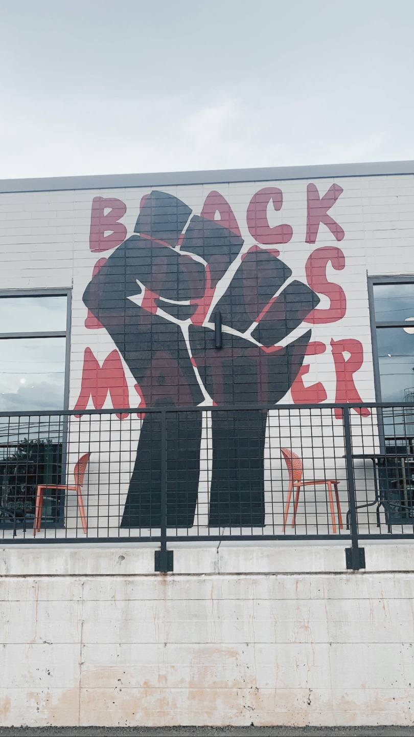 Weekend in Charlotte by popular N.C. travel blog, I'm Fixin' To: image of a Black Lives Matter wall mural.