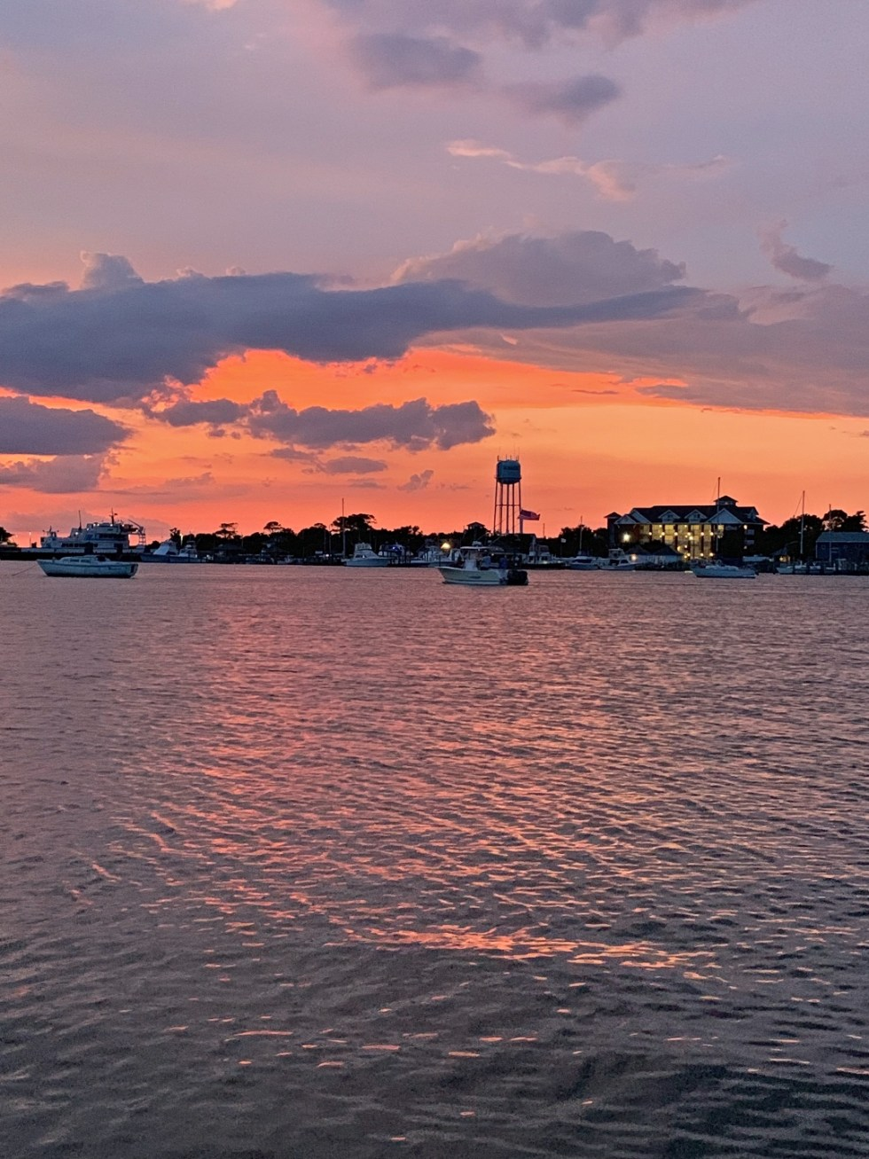 Local Love: 10 Best Places to Photograph in North Carolina - I'm Fixin' To - @mbg0112 | Best Places to Photography in North Carolina by popular N.C. lifestyle blog, I'm Fixin' To: image of a orange sunset at Silver Lake on Ocracoke Island.