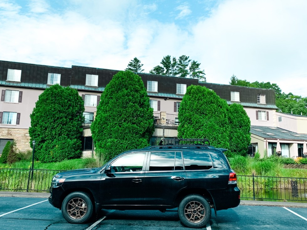 Where to Stay in Blowing Rock: a Meadowbrook Inn Review - I'm Fixin' To - @mbg0112 | Meadow Brook Inn Blowing Rock by popular N.C. travel blog, I'm Fixin' To: image of a black Toyota parked in front of Meadow Brook Inn.