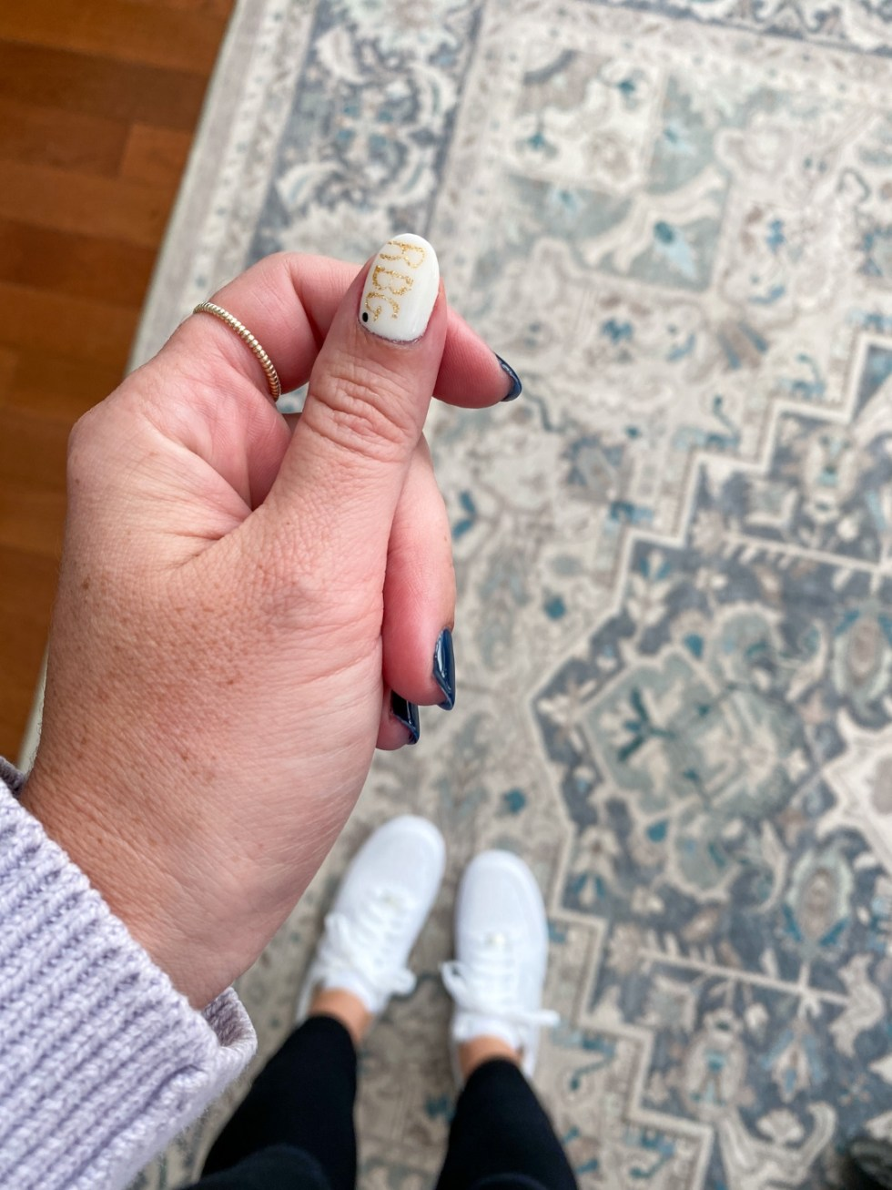 Civic Engagement Fashion Top Picks for Women - I'm Fixin' To - @mbg0112 | Civic Engagement by popular N.C. fashion blog, I'm Fixin' To: image of a woman with a RBG accent nail.