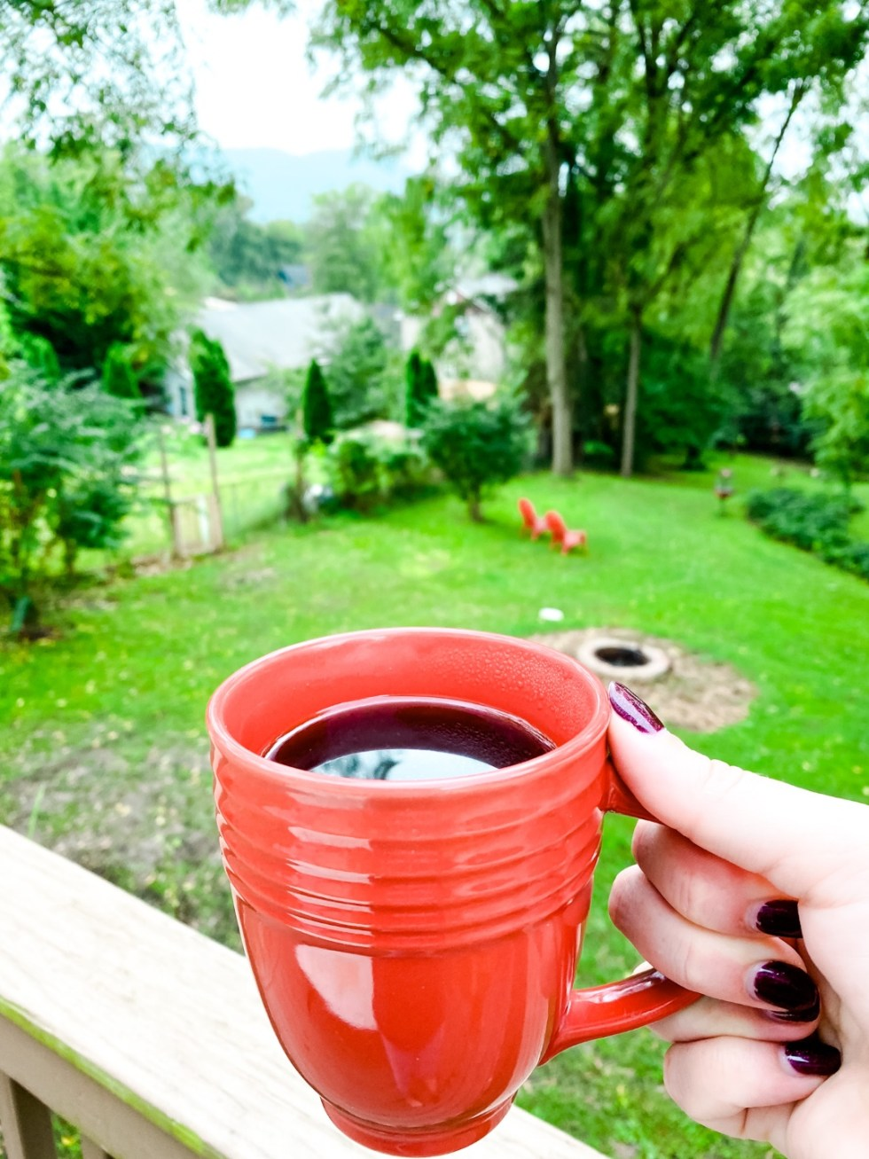 A Casual Weekend in Asheville: the Best Things to Do with your Dogs - I'm Fixin' To - @mbg0112   Weekend In Asheville by popular NC travel blog, I'm Fixin' To: image of a woman holding a red coffee mug.