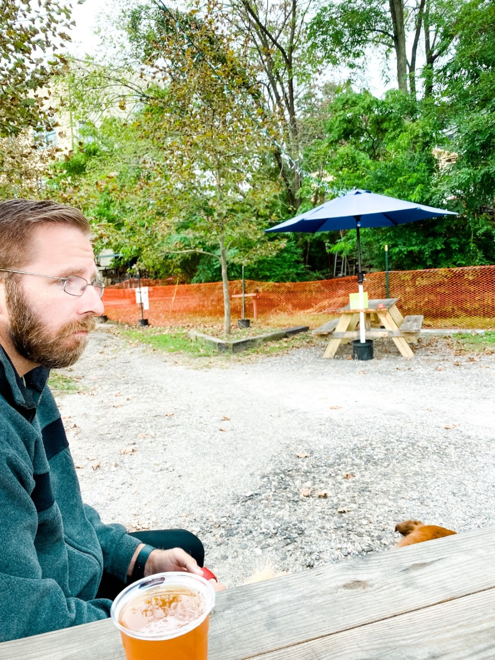 A Casual Weekend in Asheville: the Best Things to Do with your Dogs - I'm Fixin' To - @mbg0112   Weekend In Asheville by popular NC travel blog, I'm Fixin' To: image of a man sitting outside at Wedge Brewing Co.
