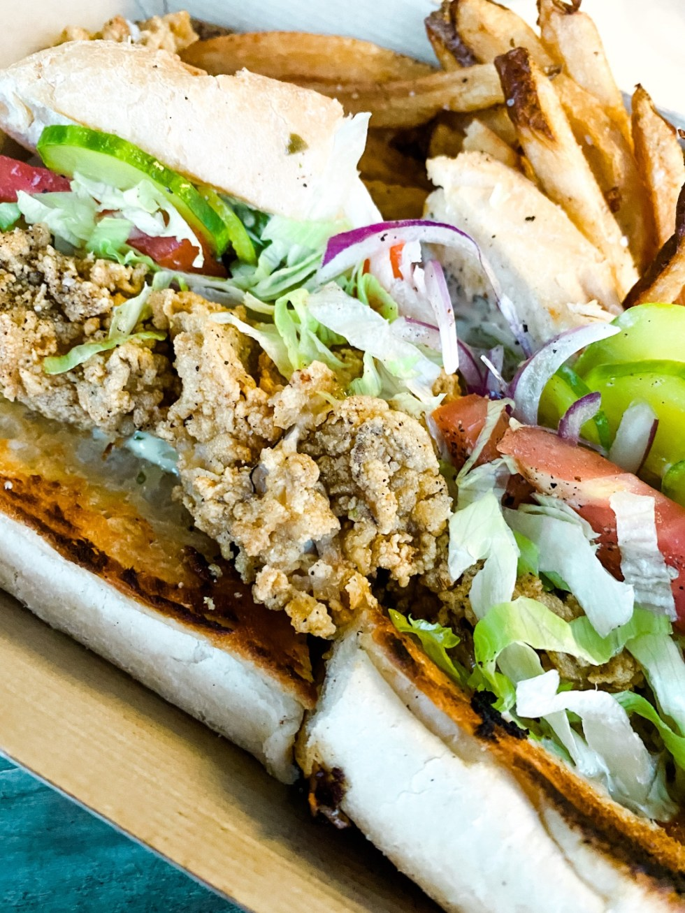 A Casual Weekend in Asheville: the Best Things to Do with your Dogs - I'm Fixin' To - @mbg0112   Weekend In Asheville by popular NC travel blog, I'm Fixin' To: image of a fried chicken sandwich and fries.