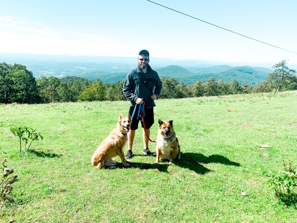 A Casual Weekend in Asheville: the Best Things to Do with your Dogs - I'm Fixin' To - @mbg0112   Weekend In Asheville by popular NC travel blog, I'm Fixin' To: image of a man standing outside with his two dogs.