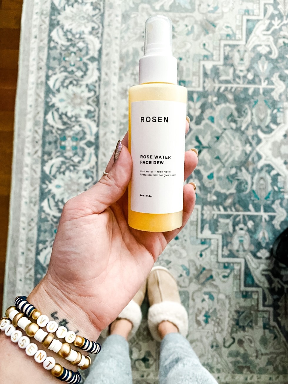 Recent Beauty Favorites: 4 Black Owned Beauty Brands at Nordstrom - I'm Fixin' To - @mbg0112 |Black Owned Beauty by popular N.C. beauty blog, I'm Fixin' To: image of a woman holding a bottle of Rosen Rose Water Face Dew.
