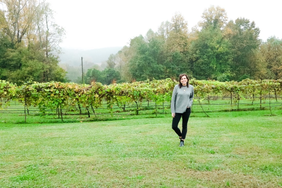 Western NC Wineries: 6 Wineries to Visit During your Next Girls' Weekend - I'm Fixin' To - @mbg0112 |Western NC Wineries by popular NC blog, I'm Fixin' To: image of a woman at Carolina Heritage vineyard and winery.