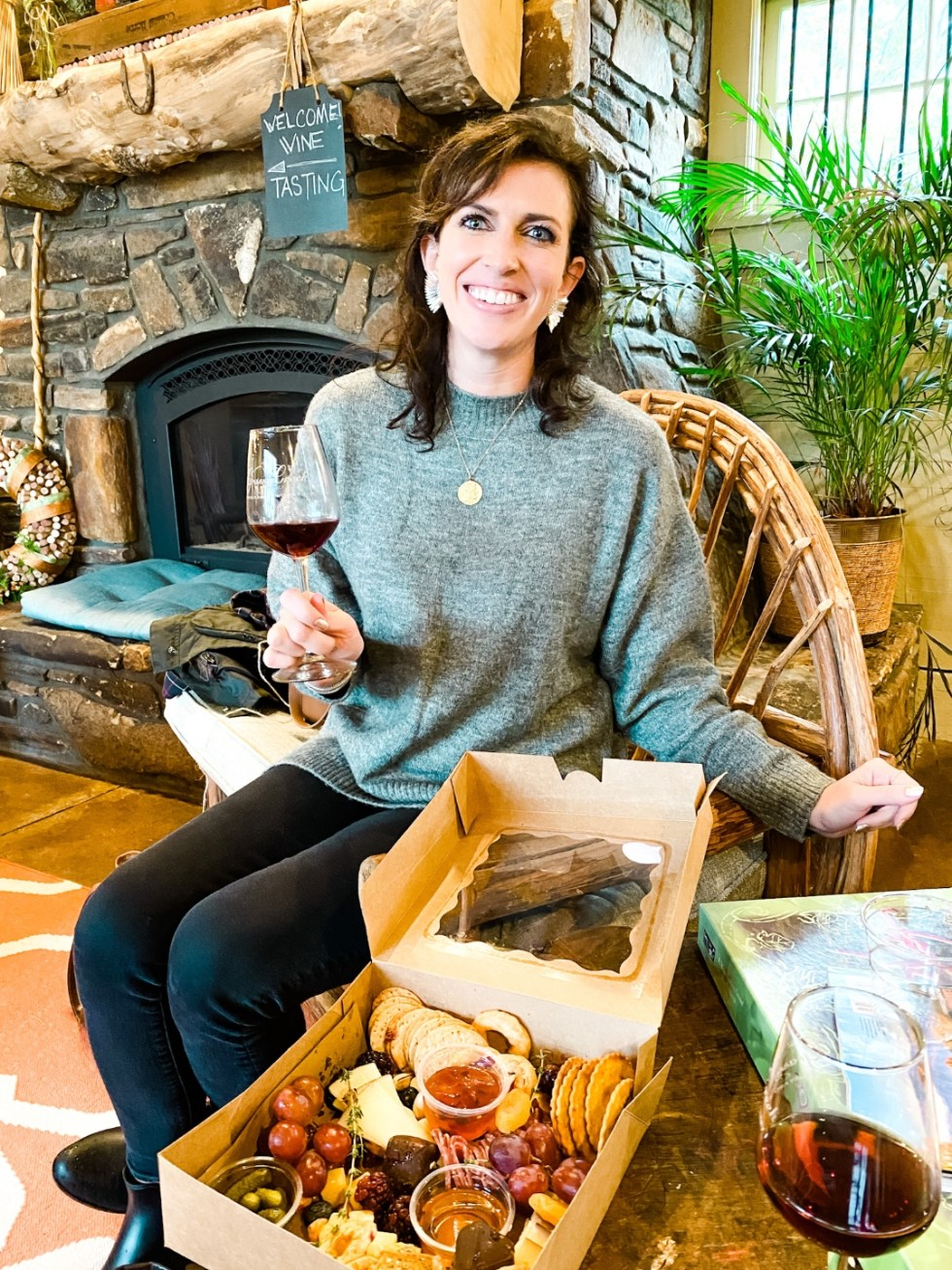 Western NC Wineries: 6 Wineries to Visit During your Next Girls' Weekend - I'm Fixin' To - @mbg0112 |Western NC Wineries by popular NC blog, I'm Fixin' To: image of a woman at Grassy Creek vineyard and Winery.