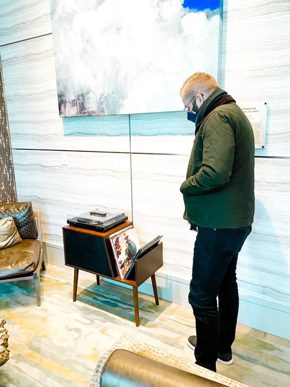 Christmas in Asheville NC by popular NC lifestyle blog, I'm Fixin' To: image of s man looking at some vinyl records.