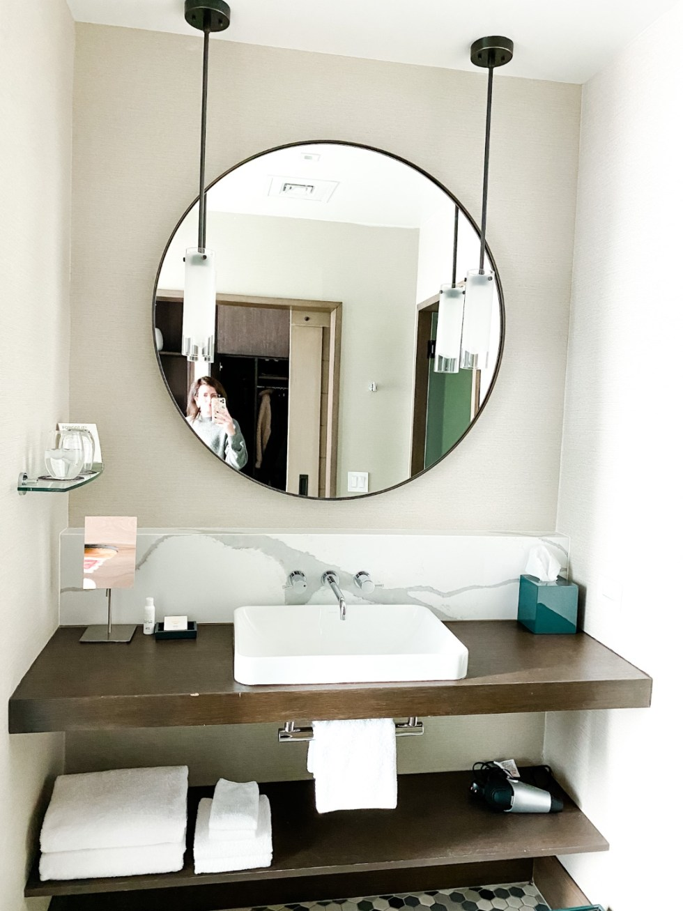 Christmas in Asheville: a Weekend Getaway During the Holidays - I'm Fixin' To - @imfixintoblog |Christmas in Asheville NC by popular NC lifestyle blog, I'm Fixin' To: image of a bathroom vanity with a round black mirror.