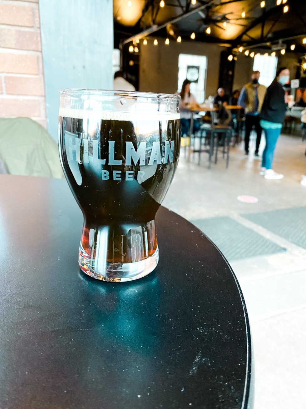 Christmas in Asheville: a Weekend Getaway During the Holidays - I'm Fixin' To - @imfixintoblog |Christmas in Asheville NC by popular NC lifestyle blog, I'm Fixin' To: image of a glass of beer at Hillman Beer.