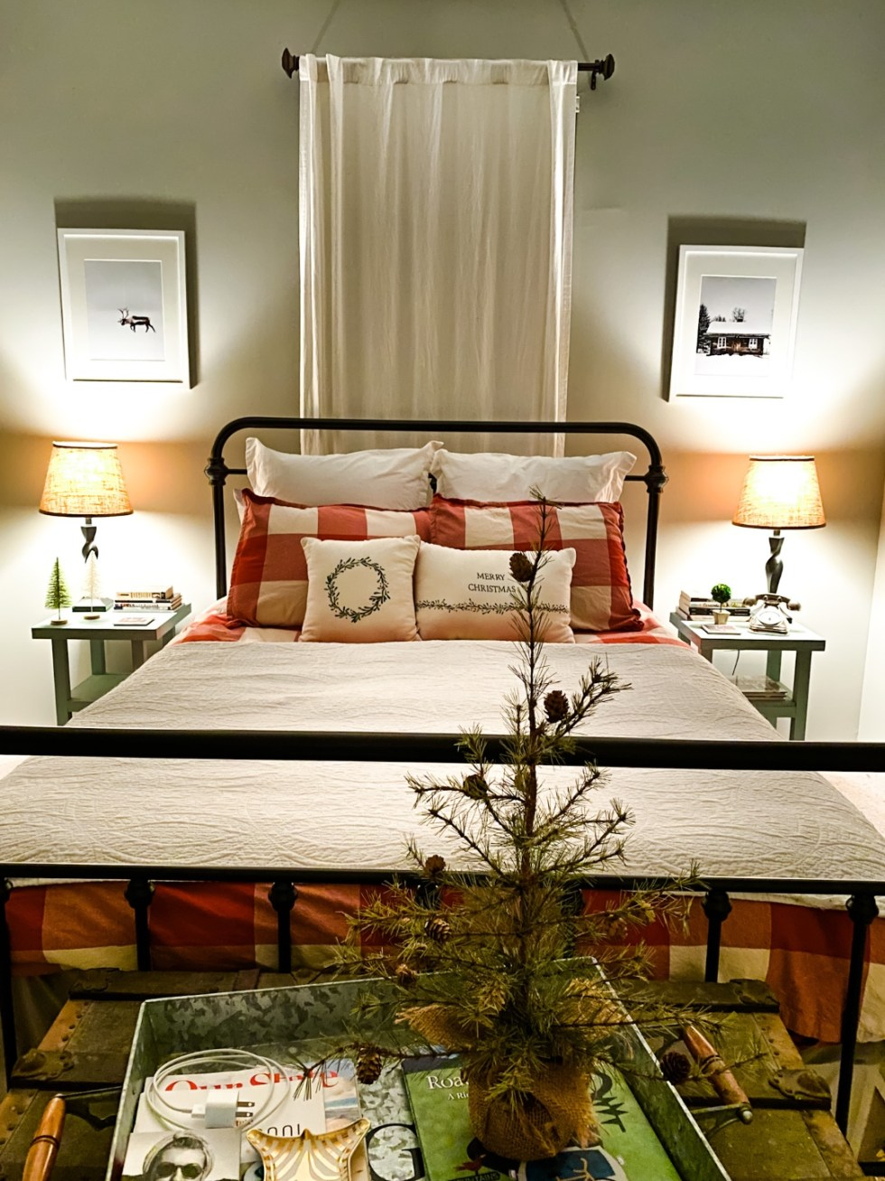 Home Decor: 7 Winter Art Prints for your Gallery Wall - I'm Fixin' To - @imfixintoblog |Winter Art Prints by popular NC life and style blog, I'm Fixin' To: image of two winter art prints hanging on a bedroom wall next to a bed with red and white buffalo plaid bedding.