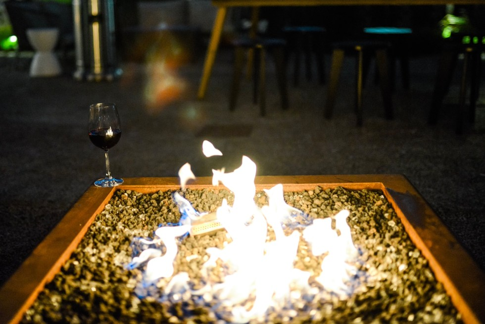 Restaurants with Patios in the Triangle by popular NC lifestyle blog, I'm Fixin' To: image of a outdoor fire pit.