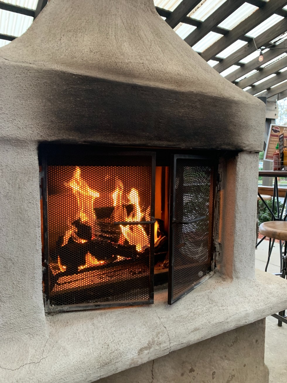 Restaurants with Patios in the Triangle by popular NC lifestyle blog, I'm Fixin' To: image of an outdoor fireplace.