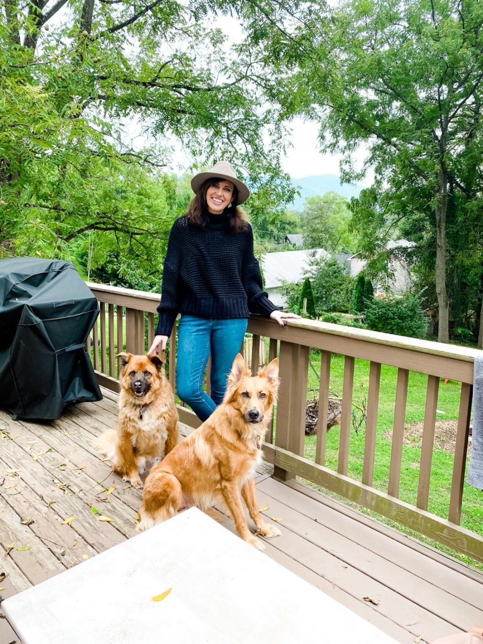 2020, a Year in Review: our Travel Adventures - I'm Fixin' To - @imfixintoblog |Year in Review by popular NC travel blog, I'm Fixin' To: image of a woman standing on a wooden deck with her two dogs.