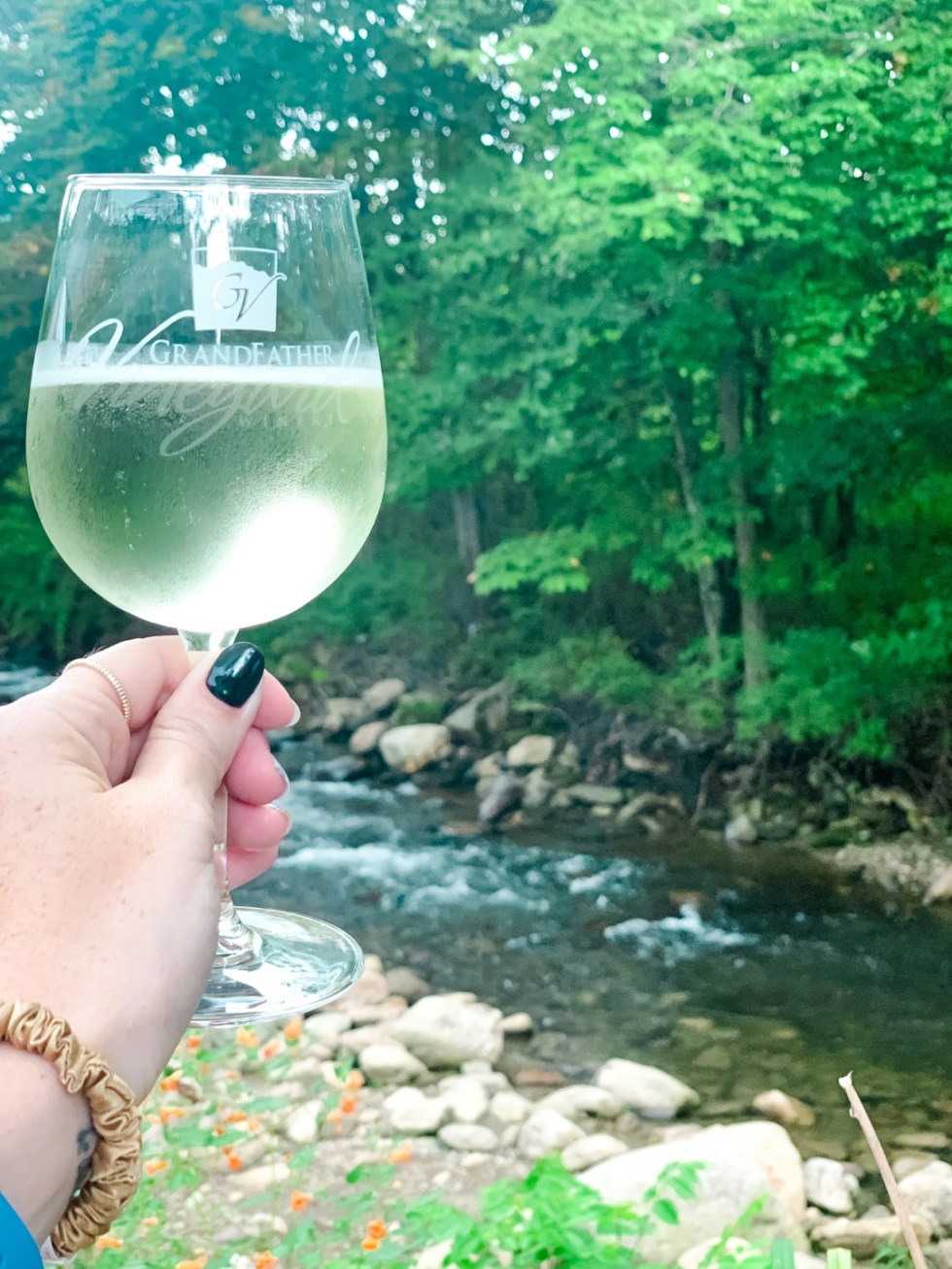 2020, a Year in Review: our Travel Adventures - I'm Fixin' To - @imfixintoblog |Year in Review by popular NC travel blog, I'm Fixin' To: image of a a woman holding a glass of white wine.