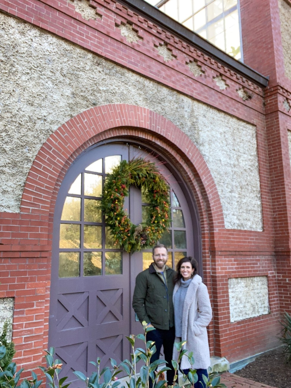Moments to be Grateful for by popular NC lifestyle blog, I'm Fixin' To: image of a man and woman standing together in front of purple door with a large wreath hanging on it.