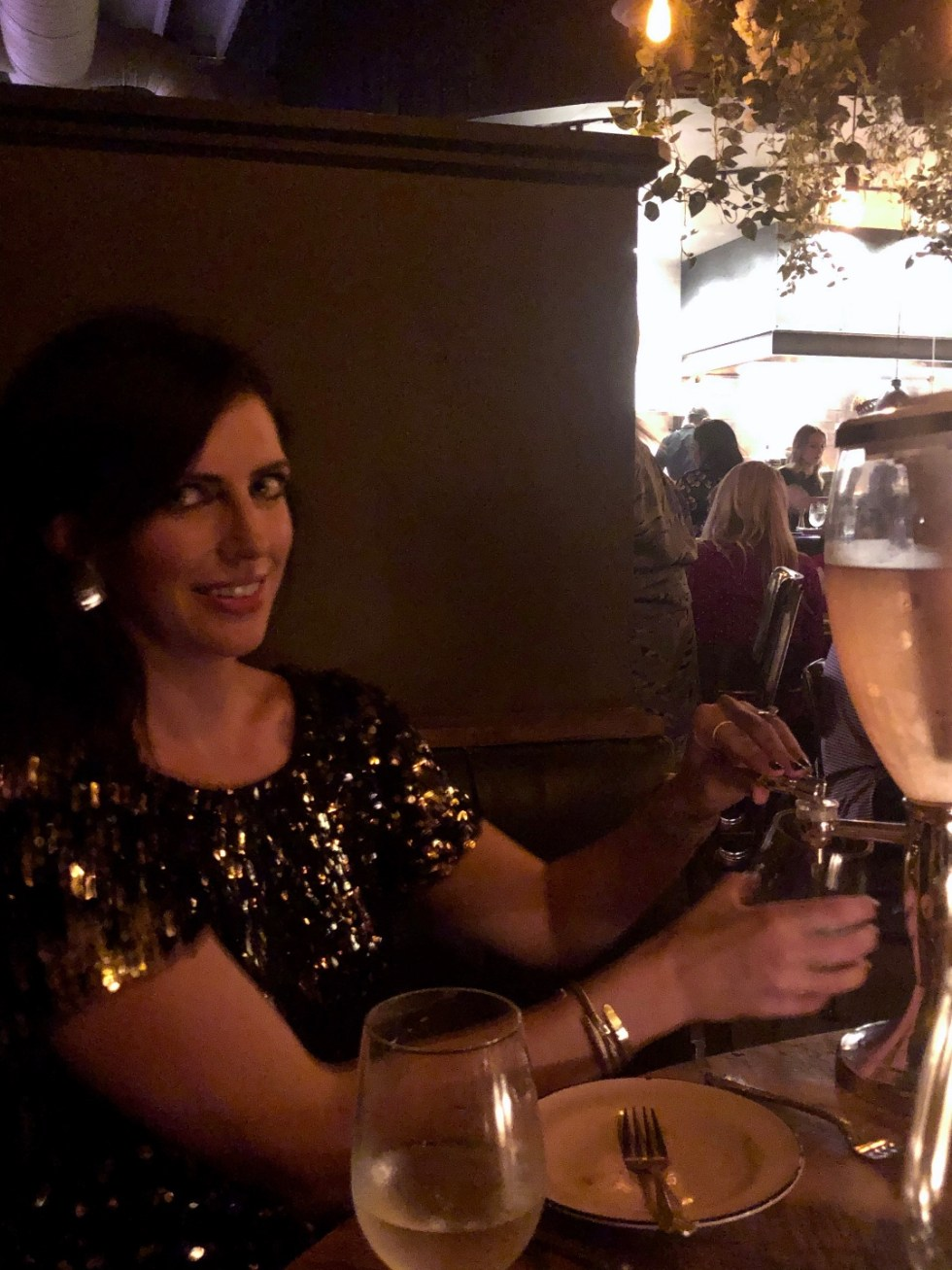 20 Moments I am Grateful for in 2020 - I'm Fixin' To - @imfixintoblog |Moments to be Grateful for by popular NC lifestyle blog, I'm Fixin' To: image of a woman wearing a sequin dress and filling her glass from a drink dispenser.