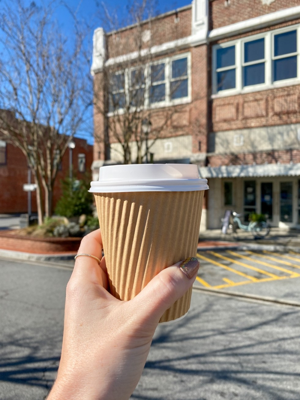 A Guide to Greenville, NC - I'm Fixin' To - @imfixintoblog |Things to do in Greenville NC by popular NC blog, I'm Fixin' To: image of a woman holding a coffee cup.