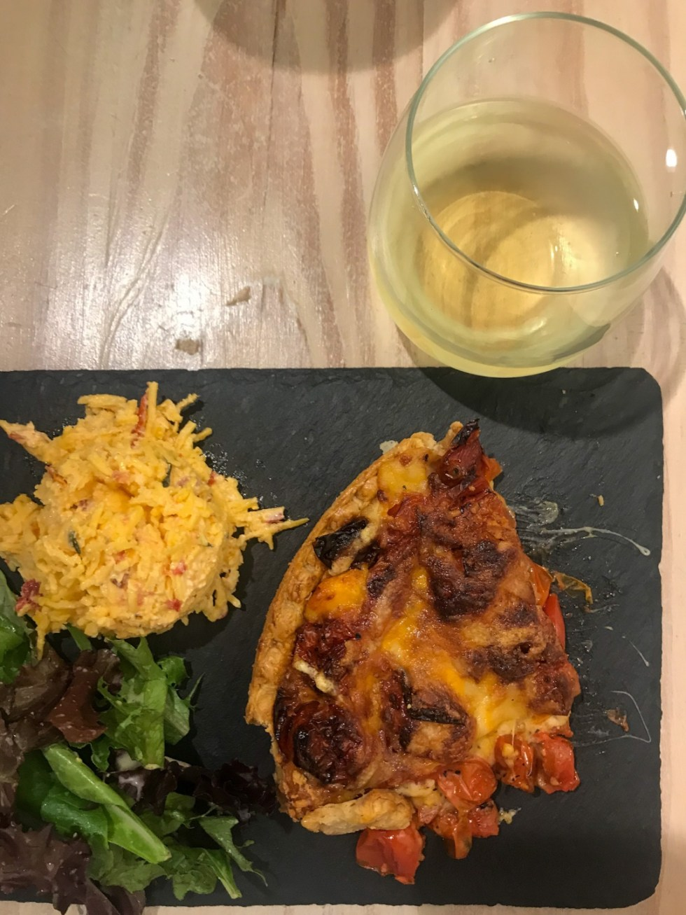 Things to do in Greenville NC by popular NC blog, I'm Fixin' To: image of pizza, salad, and a glass of white wine.