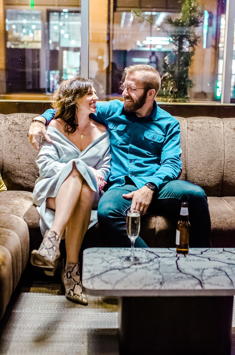 5 Lovely Valentine Date Night Ideas When Social Distancing - I'm Fixin' To - @imfixintoblog |Valentine's Date Night Ideas by popular NC lifestyle blog, I'm Fixin' To: image of a husband and wife sitting together on brown sectional couch.
