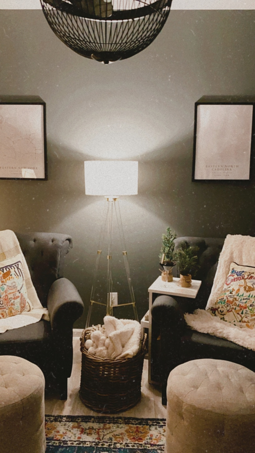How to Make your Home Cozy: 10 Easy Ways - I'm Fixin' To - @imfixintoblog |How to Make Your Home Cozy by popular NC life and style blog, I'm Fixin' To: image of a sitting area with grey tuft armchairs, tan tuft ottomans, floor lamp, and embroidered throw pillows.